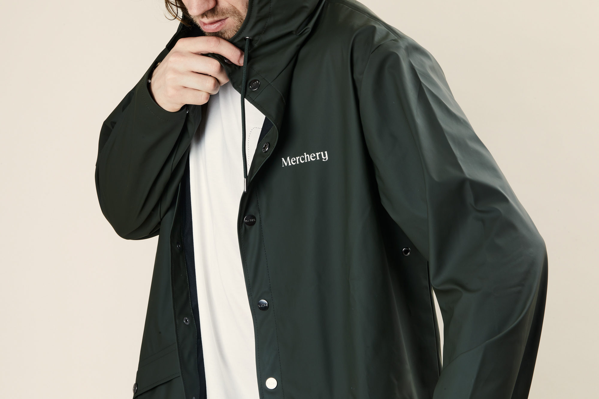 Sustainable branded rains coat Merchery recycled polyester unisex green