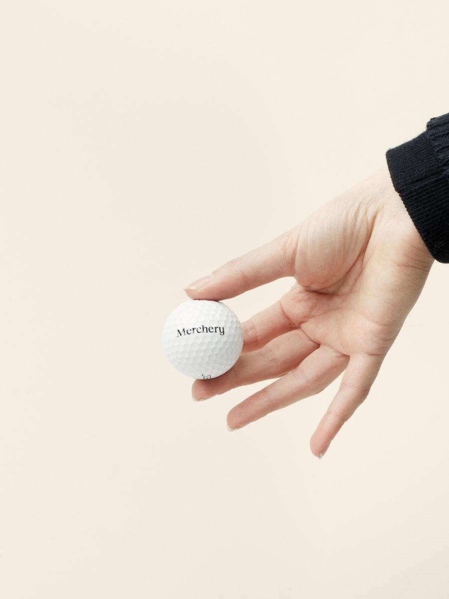 Personalised golf balls - Custom sustainable corporate gift - Merchery